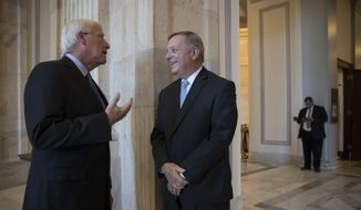 Sen. Roger Wicker, R-Miss., left, speaks with Sen. Dick Durbin, D-Ill., the minority whip, before doing TV news interviews at the Capitol in Washington, Tuesday, June 20, 2017. (AP Photo/J. Scott Applewhite)