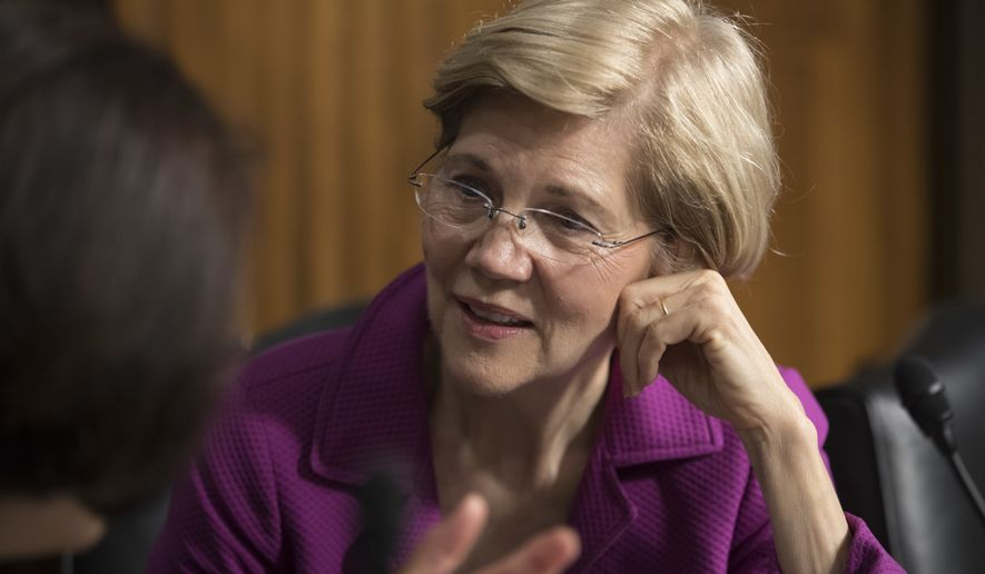 Sen. Elizabeth Warren, D-Mass., confers with Sen. Mazie Hirono, D-Hawaii, left, before the start of a Senate Armed Services Committee hearing at the Capitol in Washington, Tuesday, June 20, 2017. (AP Photo/J. Scott Applewhite)