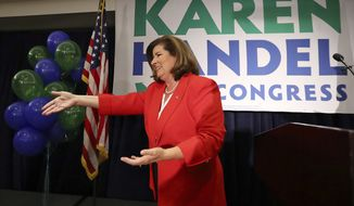 Karen Handel makes an early appearance to thank her supporters after the first returns come in during her election night party in the 6th District race with Jon Ossoff on Tuesday, June 20, 2017, in Atlanta. (Curtis Compton/Atlanta Journal-Constitution via AP)