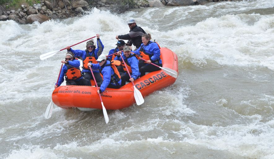 Rafting on the Payette River in Idaho, with the author at the port bow (in white hat).  (Photo by Linzie Long)