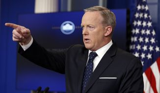 White House press secretary Sean Spicer points to a question during a briefing at the White House, Tuesday, June 20, 2017 in Washington. (AP Photo/Alex Brandon)