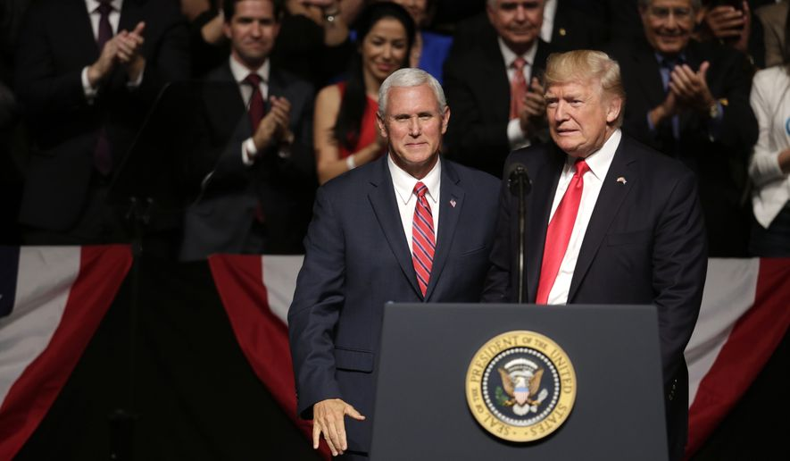 Vice President Mike Pence, left, stands with President Donald Trump at an event where Trump announced a revised Cuba policy aimed at stopping the flow of U.S. cash to the country's military and security services while maintaining diplomatic relations, Friday, June 16, 2017, in Miami. (AP Photo/Lynne Sladky)