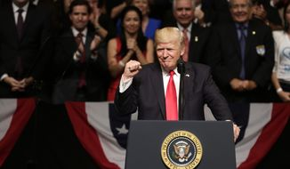 President Donald Trump clenches his fist as he announces a revised Cuba policy aimed at stopping the flow of U.S. cash to the country's military and security services while maintaining diplomatic relations, Friday, June 16, 2017, in Miami. (AP Photo/Lynne Sladky) ** FILE **