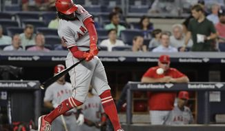 Los Angeles Angels' Cameron Maybin swings on a home run during the seventh inning of the team's baseball game against the New York Yankees on Tuesday, June 20, 2017, in New York. (AP Photo/Frank Franklin II)
