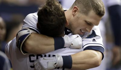 Tampa Bay Rays' Corey Dickerson, right, hugs Steven Souza Jr., after Dickerson hit a home run off Cincinnati Reds starting pitcher Amir Garrett during the fourth inning of a baseball game Tuesday, June 20, 2017, in St. Petersburg, Fla. (AP Photo/Chris O'Meara)