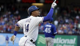 Texas Rangers' Carlos Gomez points skyward as he approaches the plate after hitting a solo home run off of Toronto Blue Jays' Francisco Liriano, rear, during the first inning of a baseball game, Tuesday, June 20, 2017, in Arlington, Texas. (AP Photo/Tony Gutierrez)