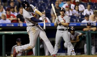 St. Louis Cardinals' Stephen Piscotty hits a go-ahead two-run double off Philadelphia Phillies relief pitcher Casey Fien during the 11th inning of a baseball game, Tuesday, June 20, 2017, in Philadelphia. St. Louis won 8-1 in 11 innings. (AP Photo/Matt Slocum)