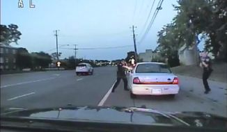 In this image made from July 6, 2016, video captured by a camera in the squad car of St. Anthony Police officer Jeronimo Yanez, the Minnesota police officer shoots at Philando Castile in the vehicle during a traffic stop in Falcon Heights, Minn. Yanez's backup officer Joseph Kauser is seen standing on the passenger side of the vehicle. The video was made public by the Minnesota Bureau of Criminal Apprehension and the Ramsey County Attorney's Office, Tuesday, June 20, 2017, just days after the officer was acquitted on all counts in the case. (St. Anthony Police department via AP)