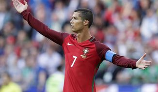 FILE - In this Sunday, June 18, 2017 file photo, Portugal's Cristiano Ronaldo calls for referee's attention during the Confederations Cup, Group A soccer match between Portugal and Mexico, at the Kazan Arena, Russia. (AP Photo/Thanassis Stavrakis, File)
