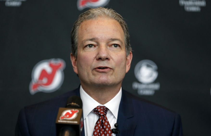 FILE -  In this Tuesday, June 2, 2015 file photo, New Jersey Devils general manager Ray Shero speaks during a NHL hockey news conference introducing John Hynes as the team's new head coach in Newark, N.J. If anyone needs the No. 1 pick in the NHL Draft, it's the New Jersey Devils. After making the playoffs for 20 of 22 seasons, the Devils have fallen on hard times. They have missed the postseason for the last five seasons and they are coming off their worst season in nearly three decades.(AP Photo/Julio Cortez, File)
