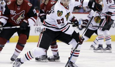 FILE - In this Feb. 2, 2017, file photo, Chicago Blackhawks defenseman Trevor van Riemsdyk (57) controls the puck in the first period during an NHL hockey game against the Arizona Coyotes, in Glendale, Ariz. The Golden Knights could land  van Riemsdyk in their expansion draft on Wednesday, June 21.(AP Photo/Rick Scuteri)