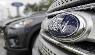 FILE - In this Jan. 12, 2015, file photo, Ford vehicles sit on the lot at a car dealership, in Brandon, Fla. Ford Motor Co. will export vehicles from China to the U.S. for the first time starting in 2019, announced Tuesday, June 20, 2017. Ford will move production of its Ford Focus small car from the U.S. to China, where it already makes the Focus for Chinese buyers. (AP Photo/Chris O'Meara, File)