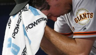 San Francisco Giants pitcher Derek Law (64) sits in the dugout after being relieved in the eighth inning of a baseball game against the Atlanta Braves Monday, June 19, 2017, in Atlanta. The Braves won 9-0. (AP Photo/John Bazemore)