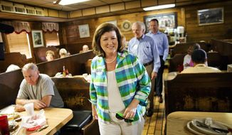 Karen Handel, Republican candidate for Georgia's 6th Congressional District greets diners during a campaign stop at Old Hickory House in Tucker, Ga., Monday, June 19, 2017. The race between Handel and Democrat Jon Ossoff is seen as a significant political test for the new Trump administration. The district traditionally goes Republican, but most consider the race too close to call as voters head to the polls on Tuesday. (AP Photo/David Goldman)