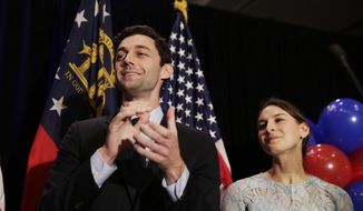 Democratic candidate for 6th Congressional District Jon Ossoff, left, concedes to Republican Karen Handel while joined by his fiancee Alisha Kramer at his election night party in Atlanta, Tuesday, June 20, 2017. (AP Photo/David Goldman) ** FILE **