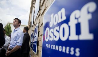 Jon Ossoff, Democratic candidate for Georgia's 6th Congressional District, talks to reporters during a stop at a campaign office in Chamblee, Ga., Monday, June 19, 2017. The race between Ossoff and Republican Karen Handel is seen as a significant political test for the new Trump Administration. The district traditionally goes Republican, but most consider the race too close to call as voters head to the polls on Tuesday. (AP Photo/David Goldman)