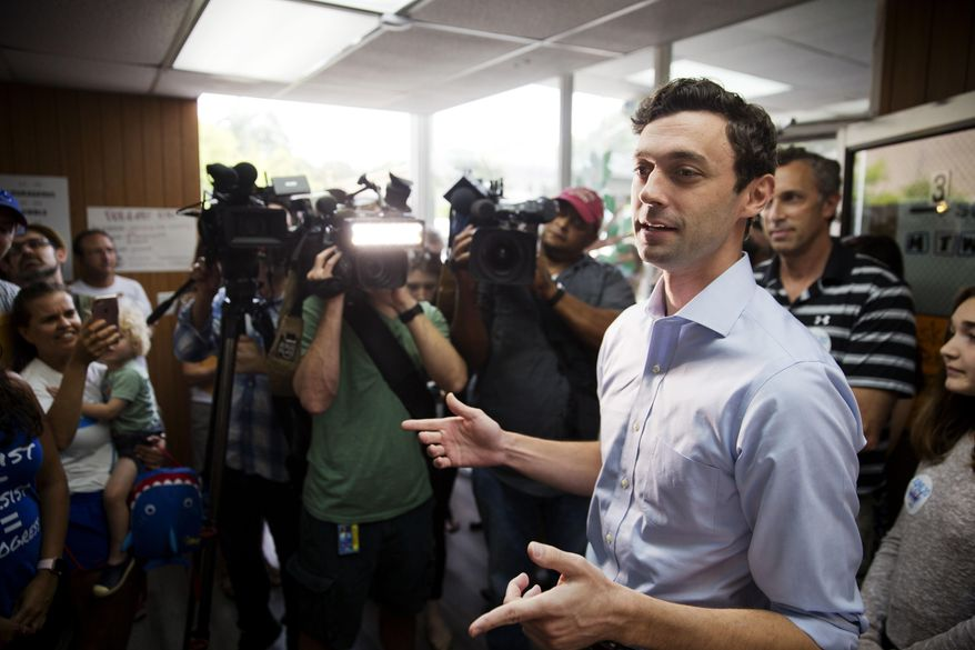 Jon Ossoff, Democratic candidate for Georgia's 6th Congressional District talks to supporters during a stop at a campaign office in Chamblee, Ga., Monday, June 19, 2017. The race between Ossoff and Republican Karen Handel is seen as a significant political test for the new Trump Administration. The district traditionally goes Republican, but most consider the race too close to call as voters head to the polls on Tuesday. (AP Photo/David Goldman)