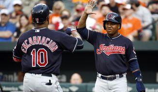 Cleveland Indians' Jose Ramirez, right, greets teammate Edwin Encarnacion at home plate after scoring on Encarnacion's two-run home run in the first inning of a baseball game against the Baltimore Orioles in Baltimore, Tuesday, June 20, 2017. (AP Photo/Patrick Semansky)