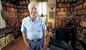 In this July 4, 2014 photo, Forrest Fenn poses at his Santa Fe, N.M., home. New Mexico's top law enforcement officer is asking Fenn, the author and antiquities dealer who inspired thousands to comb remote corners of the West in vain for a chest of gold and jewels to end the treasure hunt. The plea from New Mexico State Police Chief Pete Kassetas follows what authorities believe is the latest death related to the hunt for Fenn's hidden treasure. (Luis Sanchez Saturno/Santa Fe New Mexican via AP)