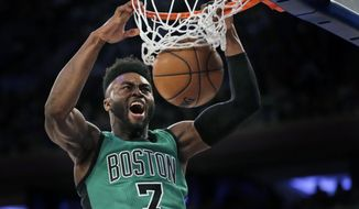 FILE - In this April 2, 2017, file photo, Boston Celtics' Jaylen Brown dunks during the second half of the NBA basketball game against the New York Knicks, in New York. Sixty NBA draft hopefuls will hear their name called as members of the 2017 rookie class.  For many of the top picks it will mark the start of the transition from college underclassman to instant millionaire.(AP Photo/Seth Wenig, File)