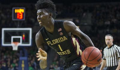 FILE - In this Feb. 11, 2017, file photo, Florida State's Jonathan Isaac (1) drives during the second half of an NCAA college basketball game against Notre Dame, in South Bend, Ind. Isaac's size and perimeter skills have made him a likely lottery pick in Thursday's NBA draft. (AP Photo/Robert Franklin, File)