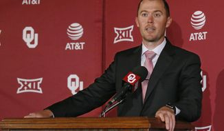In this Wednesday, June 7, 2017 photo, Lincoln Riley speaks at a news conference where he was announced as Oklahoma's football coach in Norman, Okla. Oklahoma's Board of Regents formally approved Riley's hiring during a meeting Tuesday, June 20. (AP Photo/Sue Ogrocki)