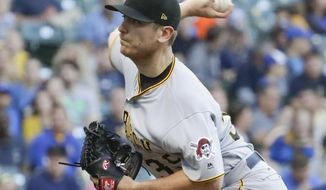 Pittsburgh Pirates starting pitcher Chad Kuhl throws during the first inning of a baseball game against the Milwaukee Brewers Tuesday, June 20, 2017, in Milwaukee. (AP Photo/Morry Gash)