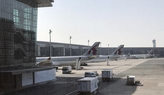 In this Friday, June 16, 2017 photo, Qatar Airways planes are seen parked at the Hamad International Airport in Doha, Qatar. The deadline for Qataris to leave neighboring Gulf Arab states has come into effect as the diplomatic standoff persists despite multiple mediation efforts. (AP Photo/Malak Harb)