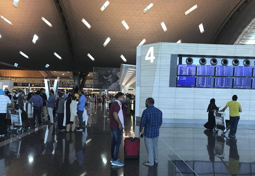 In this Monday, June 12, 2017 photo, passengers arrive at the Hamad International Airport in Doha, Qatar. An AP videojournalist recounts her struggle to fly back home to Dubia after a diplomatic dispute with Arab Gulf countries saw Qatar, a hub of global air travel, cut off from local flight routes. (AP Photo/Malak Harb)