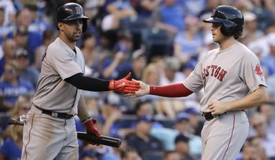 Boston Red Sox's Deven Marrero, left, celebrates with Josh Rutledge after Rutledge scored on a two-run double hit by Sandy Leon during the fourth inning of a baseball game against the Kansas City Royals Tuesday, June 20, 2017, in Kansas City, Mo. (AP Photo/Charlie Riedel)