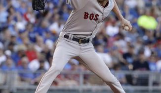 Boston Red Sox starting pitcher Chris Sale throws during the first inning of a baseball game against the Kansas City Royals Tuesday, June 20, 2017, in Kansas City, Mo. (AP Photo/Charlie Riedel)