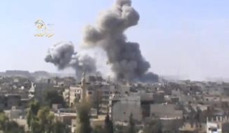 In this file image taken from video on Monday Oct. 29, 2012, obtained from the Ugarit news network, which has been authenticated based on its contents and other AP reporting, shows smoke rising from the city following heavy bombing from military warplanes, in Deir el-Zour's Jbeileh neighborhood, 450 km northeast of Damascus Syria. (AP Photo/Shaam News Network via AP video, File )