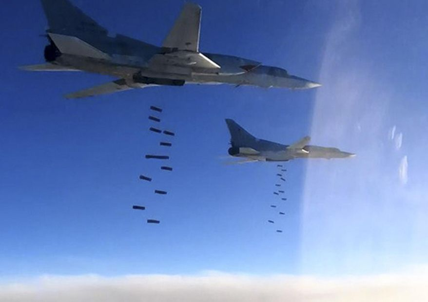 FILE -- In this file photo provided on Monday, Jan. 23, 2017 by the Russian Defense Ministry Press Service shows Russian air force Tu-22M3 bombers strike the Islamic State targets the IS around Deir el-Zour, eastern Syria. Syrian government and allied troops have inserted themselves into the battle against Islamic State militants by capturing key areas on the flanks of the coalition-led battle to seize Raqqa. They have positioned themselves as indispensable possibly spoilers in the fight to uproot the militants from Syria.(Russian Defense Ministry Press Service via AP, File)