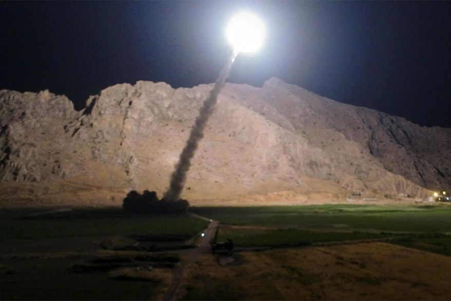 FILE - In this file picture released by the Iranian state-run IRIB News Agency on Monday, June 19, 2017, a missile is fired from city of Kermanshah in western Iran targeting the Islamic State group in Syria. Syrian government and allied troops have inserted themselves into the battle against Islamic State militants by capturing key areas on the flanks of the coalition-led battle to seize Raqqa. They have positioned themselves as indispensable possibly spoilers in the fight to uproot the militants from Syria. (IRIB News Agency, Morteza Fakhrinejad via AP, File)