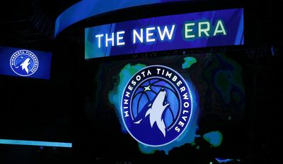 FILE - In this April 11, 2017, file photo, the new Minnesota Timberwolves logo is unveiled on the scoreboard during halftime of the team's NBA basketball game against the Oklahoma City Thunder, in Minneapolis. The Timberwolves are getting into the jersey advertisement game with a Fitbit patch in a three-year deal. The Timberwolves announced the marketing collaboration for the team's first jersey patch on Tuesday, June 20, 2017. (AP Photo/Jim Mone, File)