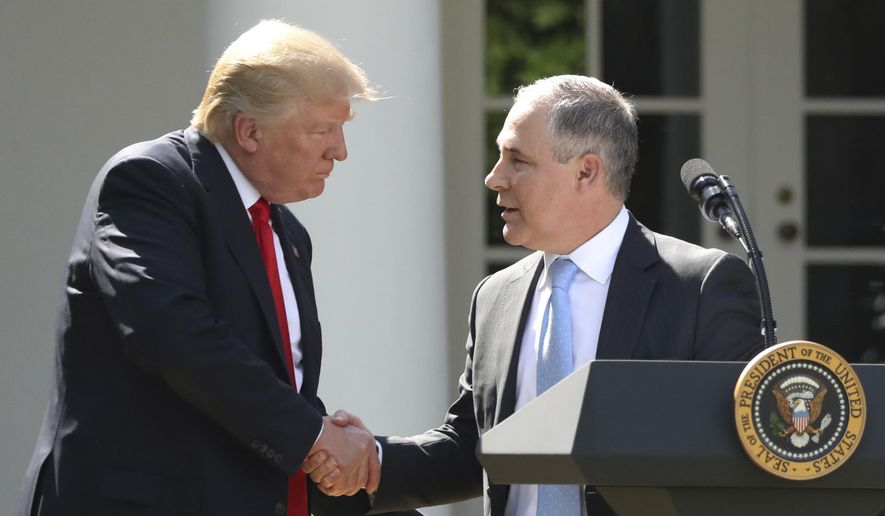 President Donald Trump shakes hands with EPA Administrator Scott Pruitt after speaking about the U.S. role in the Paris climate change accord in the Rose Garden of the White House in Washington. (AP Photo/Andrew Harnik, File)