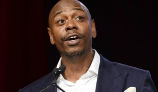 Comedian Dave Chappelle speaks at the RUSH Philanthropic Arts Foundation's Art for Life Benefit in New York, July 18, 2015. (Photo by Scott Roth/Invision/AP) ** FILE **