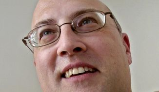 This March 11, 2005 photo shows Jeff Neville in Goodrich, Mich.  Michigan State Police Lt. Mike Shaw said the officer stabbed Wednesday, June 21, 2017  is Lt. Jeff Neville with the Bishop International Airport police.   Officials on Wednesday evacuated an airport in Flint, Michigan, where a witness said he saw an officer bleeding from his neck and a knife nearby on the ground.  Officials on Wednesday evacuated the airport, where a witness said he saw an officer bleeding from his neck and a knife nearby on the ground.  (Steve Jessmore/The Flint Journal-MLive.com via AP)