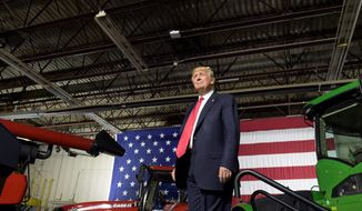 During a speech at Kirkwood Community College in Cedar Rapids, Iowa, on Wednesday, President Trump proposed new immigration rules. He also commented on Karen Handel's victory in Georgia, the proposed border wall with Mexico and tax cuts. (Associated Press)