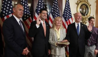 Speaker of the House Paul Ryan, R-Wis., holds a ceremonial swearing-in for Montana Republican Greg Gianforte, joined by his wife Susan and his family, and Interior Secretary Ryan Zinke, left, at the Capitol in Washington, Wednesday, June 21, 2017. (AP Photo/Manuel Balce Ceneta)