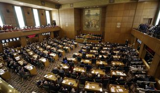 FILE - In this Jan. 9, 2017 file photo, Oregon Gov. Kate Brown delivers her inaugural speech to Oregon legislators in the Capitol House chambers in Salem, Ore. A $670 million health care tax package has passed the Oregon Legislature and now heads to Gov. Kate Brown, providing enough funds over the next two years to prevent Medicaid recipients from losing health care and avoid closing a newly-built psychiatric hospital with hundreds of patients. (AP Photo/Don Ryan, file)