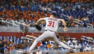 Washington Nationals' Max Scherzer delivers a pitch during the eighth inning of a baseball game, Wednesday, June 21, 2017, in Miami. Scherzer's bid for the third no-hitter of his big league career ended with one out in the eighth inning, and he then gave up two unearned runs as the Miami Marlins rallied to beat the Washington Nationals 2-1. (AP Photo/Wilfredo Lee)