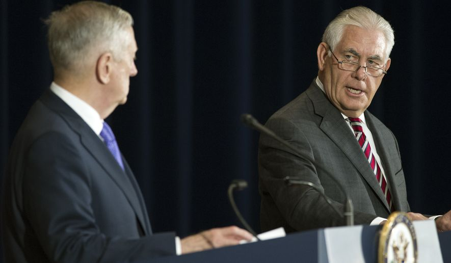 Secretary of State Rex Tillerson, right, and Secretary of Defense Jim Mattis appear at news conference following a Diplomatic and Security Dialogue Meeting with a Chinese delegation including State Counselor Yang Jiechi and military Chief of Joint Staff Fang Fenghui, at the State Department in Washington, Wednesday, June 21, 2017. (AP Photo/Cliff Owen)