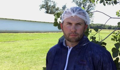 In this Tuesday, June 20, 2017, image made from a video, Bret Hendricks, a broiler manager for Tyson Foods speaks outside a chicken house in Plumerville, Ark. Hendricks is responsible for millions of chickens kept at farms near a company processing plant in nearby Dardanelle, Ark. Tyson is launching an effort to ensure the birds are handled properly and will explore ways to slaughter chickens in a more-humane way. (AP Photo/Kelly P. Kissel)