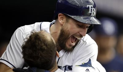 Tampa Bay Rays' Trevor Plouffe reacts as he hugs Steven Souza Jr. after Plouffe hit a home run off Cincinnati Reds starting pitcher Tim Adleman during the fourth inning of a baseball game Wednesday, June 21, 2017, in St. Petersburg, Fla. (AP Photo/Chris O'Meara)