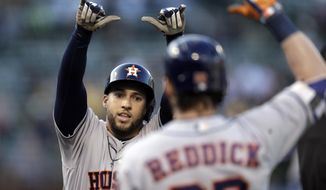 Houston Astros' George Springer, left, celebrates with Josh Reddick after hitting a home run off Oakland Athletics' Sonny Gray during the first inning of a baseball game Tuesday, June 20, 2017, in Oakland, Calif. (AP Photo/Ben Margot)