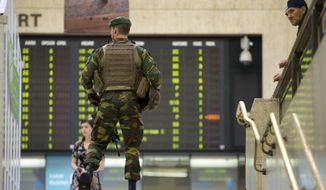 """A Belgian Army soldier patrols inside Central Station in Brussels on Wednesday, June 21, 2017. Belgian authorities said they foiled a """"terror attack"""" when soldiers shot a suspect in the heart of Brussels after a small explosion at a busy train station Tuesday on a night that continued a week of attacks in the capitals of Europe. (AP Photo/Virginia Mayo)"""