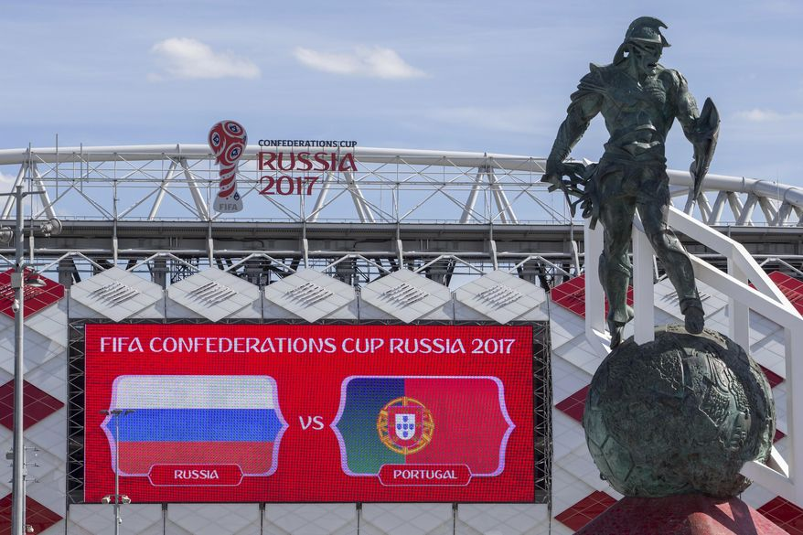 The Spartacus statue is in front of the Spartak Stadium in Moscow, Russia, Tuesday, June 20, 2017. The 25-meter high monument, a metal gladiator atop a vast soccer ball, towers outside Moscow's Spartak stadium, one of Russia's Confederations Cup stadiums. (AP Photo/Denis Tyrin)