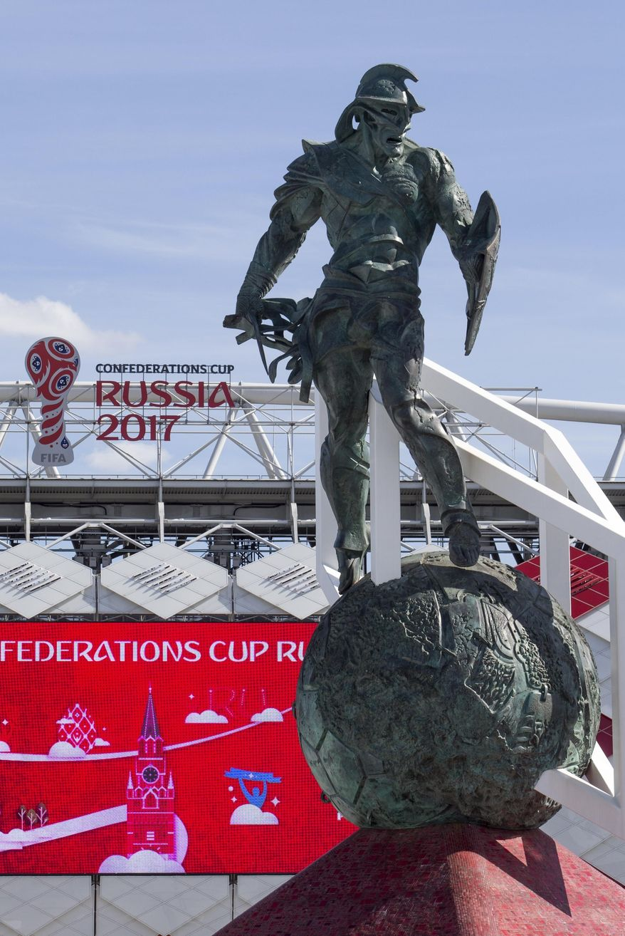 The Spartacus statue installed in front of the Spartak Stadium in Moscow, Russia, Tuesday, June 20, 2017. The 25-meter high monument, a metal gladiator atop a vast soccer ball, towers outside Moscow's Spartak stadium, one of Russia's Confederations Cup stadiums. (AP Photo/Denis Tyrin)
