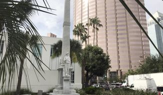A Confederate statue is seen in a small park in Tampa, Fla., Wednesday, June 21, 2017. The Hillsborough County Commission is scheduled to discuss the fate of the statue that was first erected in Tampa in 1911 in front of the courthouse. A commissioner has called for its removal. (AP Photo/Tamara Lush)